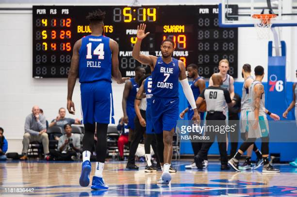 Haywood Highsmith of the Delaware Blue Coats reacts to a play with teammate Norvel Pelle as they take on the Greensboro Swarm during an NBA G League...