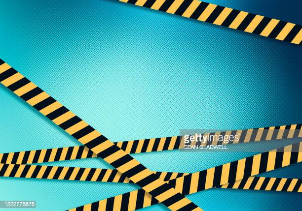 hazard tape on computer screen - cordon tape stock pictures, royalty-free photos & images