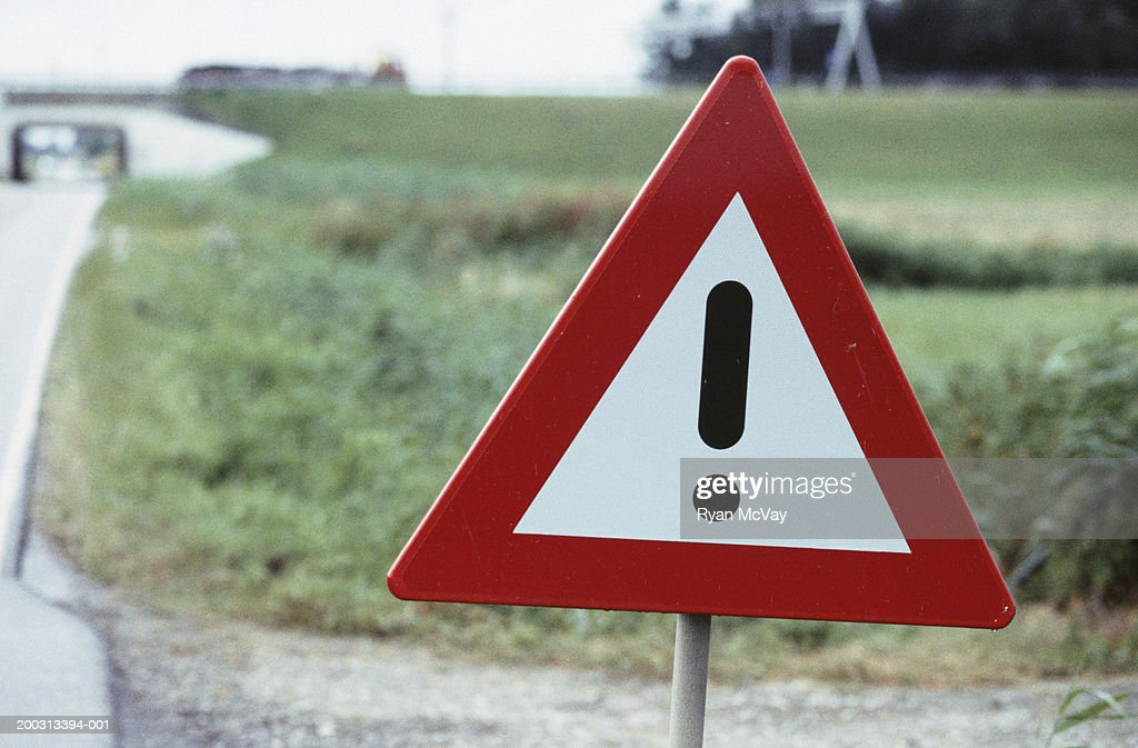 Hazard warning sign by country roadside, close-up : Stock Photo