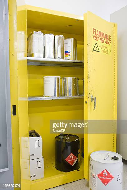 hazardous chemicals storage locker with various containers inside - flammable stock photos and pictures