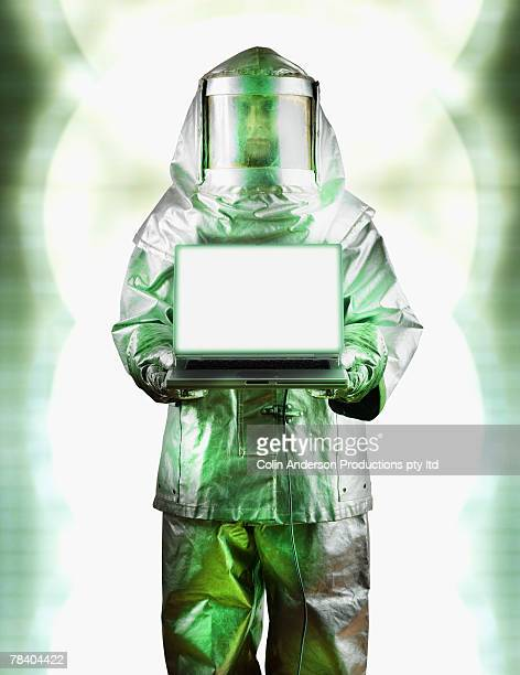 Hazardous materials specialist with a laptop computer