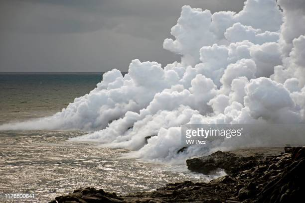 Hazardous smoke from lava flowing into the ocean. Kalapana. Hawaii. USA.
