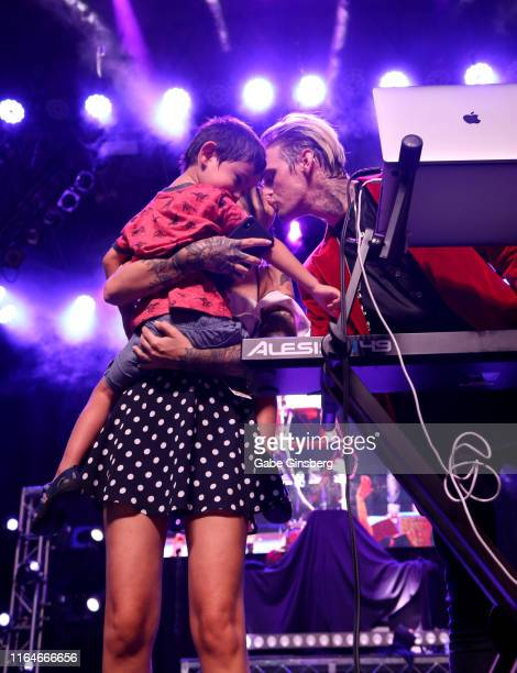 Haze Almarinez plays with a keyboard as Lina Valentina kisses singer and producer Aaron Carter during his performance during the Pop 2000 Tour at the...