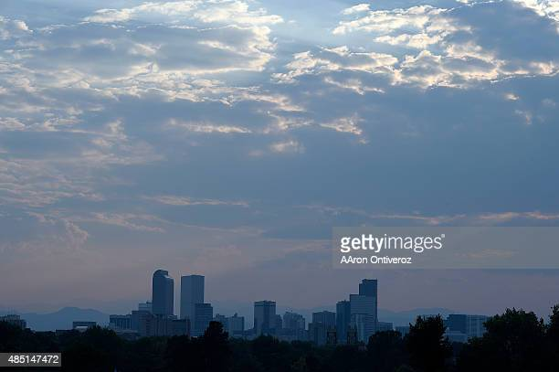 A haze from the wildfires in the Pacific Northwest covers the Denver city skyline as seen from City Park Golf Course's eighth hole on Monday August...