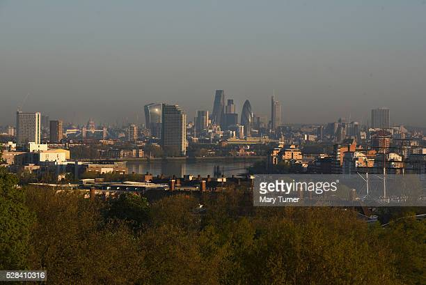 A haze of air pollution hangs over the London skyline in the early hours of the morning as London goes to the polls in its Mayoral elections with all...