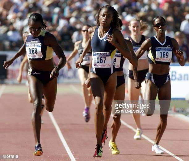 Hazel Clark leads her sister Joetta ClarkDiggs and sisterinlaw Jearl MilesClark to the finish line in the final of the Women's 800 meters 23 July...