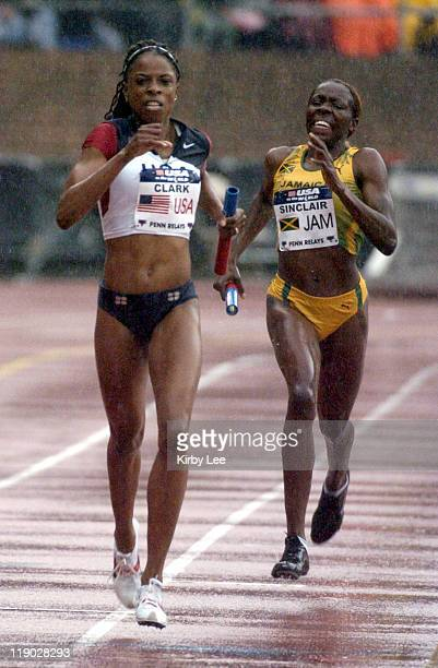 Hazel Clark of the United States holds off Kenia Sinclair of Jamaica in the women's sprint medley relay in the 111th Penn Relays at the University of...