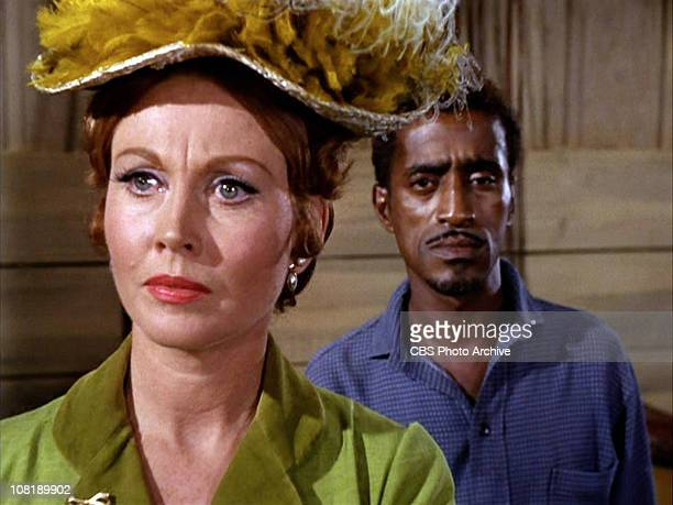 Hazel Court as Elizabeth Carter and Sammy Davis Jr as Jeremiah in The Night of the Returning Dead season 2 episode 5 of the TV series THE WILD WILD...