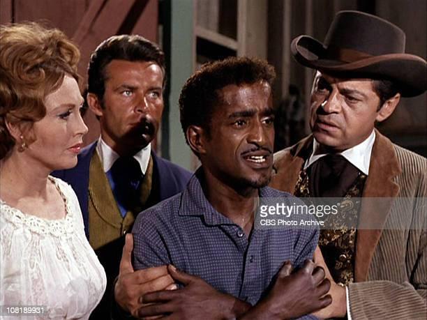Hazel Court as Elizabeth Carter Robert Conrad as James T West Sammy Davis Jr as Jeremiah and Ross Martin as Artemus Gordon in The Night of the...