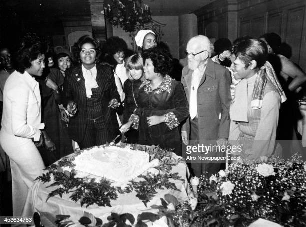 Hazel Gordy Jackson cuts her cake at surprise baby show at Beverly Hills Hotel with Nancy Wilson Burton Barbara Mitchell Iris Gordy Glodean White...