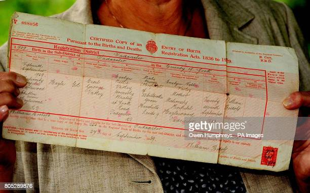 Hazel Hewitt from Norfolk shows of her birth certificate during a garden party at Hazlewood Castle Hotel where she was born after the castle was...
