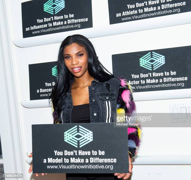 Hazel Love supports Visual Snow Initiative at TAP The Artists Project Giveback Day on August 16 2019 in Los Angeles California