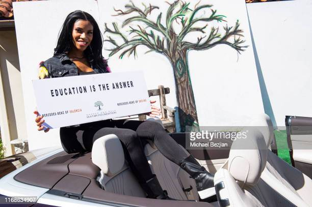 Hazel Love supports Watar Foundation at TAP The Artists Project Giveback Day on August 16 2019 in Los Angeles California