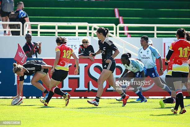 Hazel Tubic of New Zealand scores a try against China during the IRB Women's Sevens Rugby World Series at the Emirates Dubai Rugby Sevens at on...