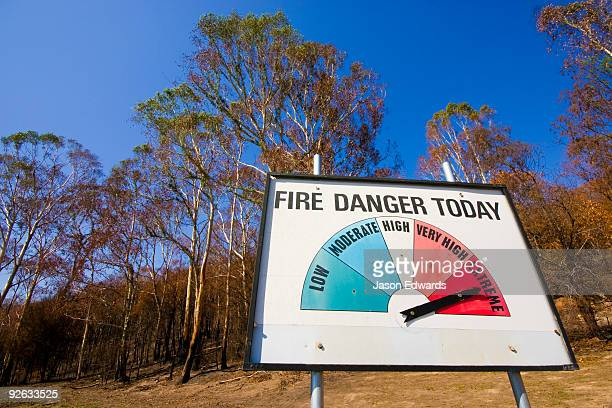 A warning sign in a rural town indicates the current fire threat.