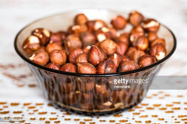 Hazelnuts in small bowl.