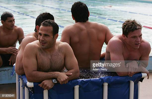 Hazem El Masri and Corey Hughes of the Bulldogs share an ice bath during a recovery session after the second week of the NRL finals between the...