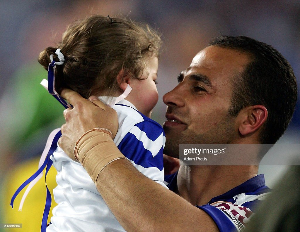 Hazem El Masri of the Bulldogs celebrate after victory in the NRL Grand Final between the Sydney Roosters and the Bulldogs held at Telstra Stadium, October 3, 2004 in Sydney, Australia.
