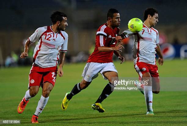 Hazem Emam of Egypt in action against Youssef Msakni of Tunisia during the African Cup of Nations qualifiers group G soccer match between Egypt and...