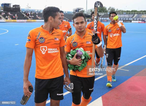 Haziq Samsul of Malaysia and Azuan Hasan of Malaysia celebrate after the quarter final match between India and Malaysia on day seven of the Hero...