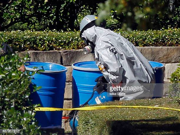 A hazmat worker carries an oxygen tank from The Village Bend East apartment complex where a second healthcare worker who has tested positive for the...