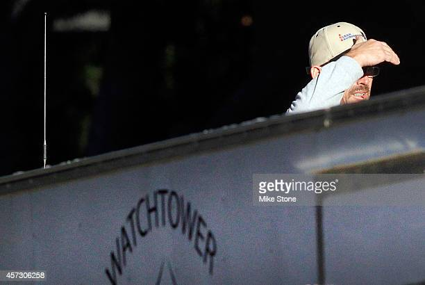 A hazmat worker peers over a trailer at the The Village Bend East apartment complex where a second health care worker who has tested positive for the...