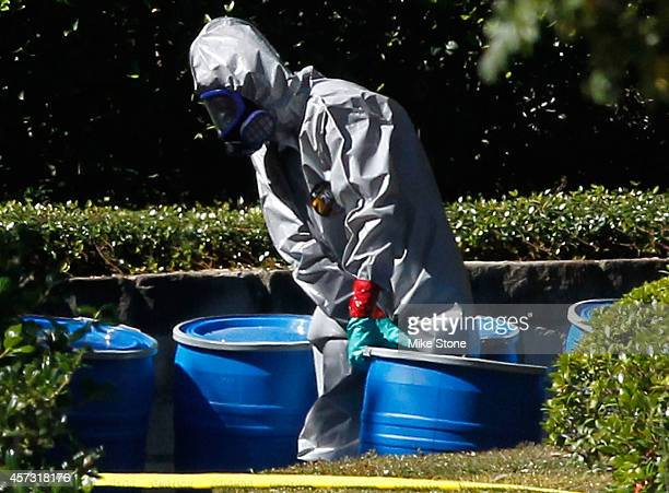 A hazmat worker removes a barrel from The Village Bend East apartment where a second healthcare worker who has tested positive for the Ebola virus...