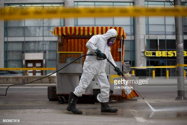 A hazmat worker scrubs the sidewalk of blood and debris after a mass killing on Yonge St at Finch Ave on April 24 2018 in Toronto Canada A suspect...