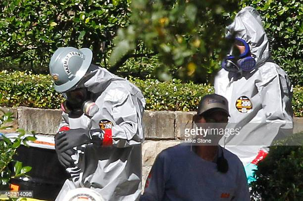 Hazmat workers prepare to enter the apartment at The Village Bend East complex where a second healthcare worker who has tested positive for the Ebola...