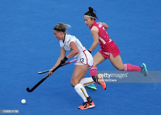 Hazuki Nagai of Japan chases down Alix Gerniers of Belgium during the Pool D game between Japan and Belgium of the FIH Womens Hockey World Cup at Lee...