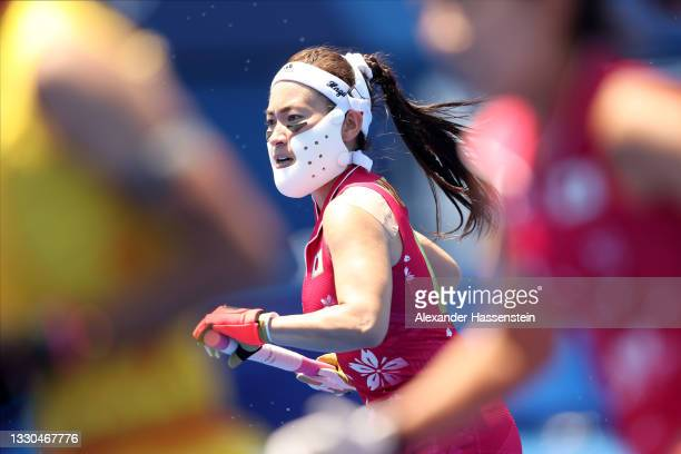 Hazuki Nagai of Team Japan runs upfield during the Women's Pool B Match against Team China on day two of the Tokyo 2020 Olympic Games at Oi Hockey...