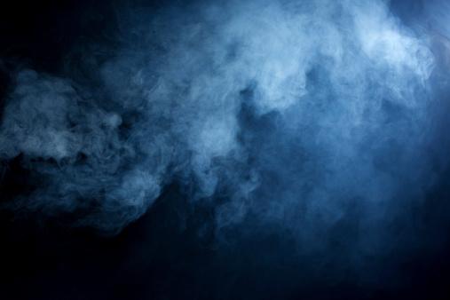 Hazy Blue Smoke on Black Background 470303669