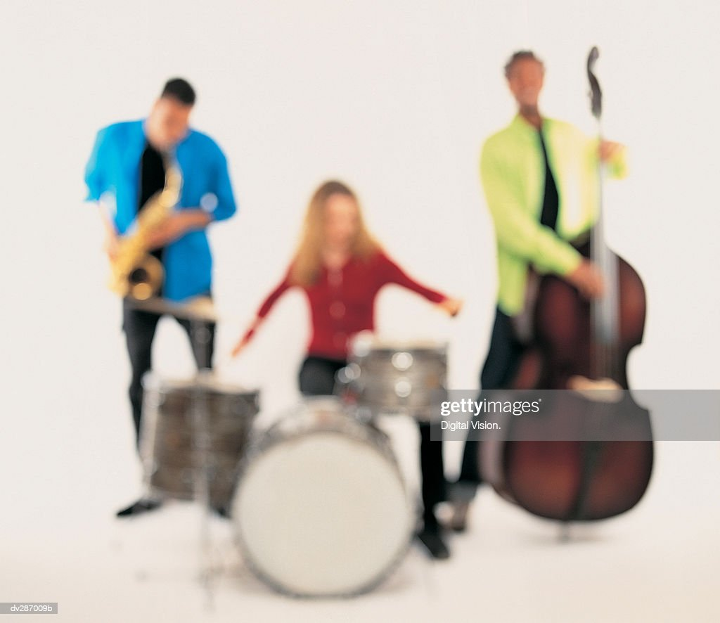 Hazy image of band with sax, drums and double bass : Stock Photo