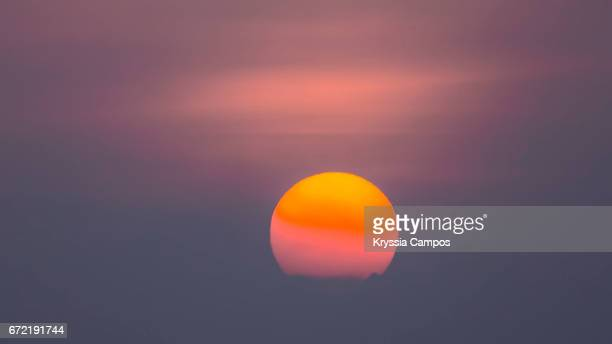 hazy morning atmosphere in costa rica / global warming - suns stock photos and pictures