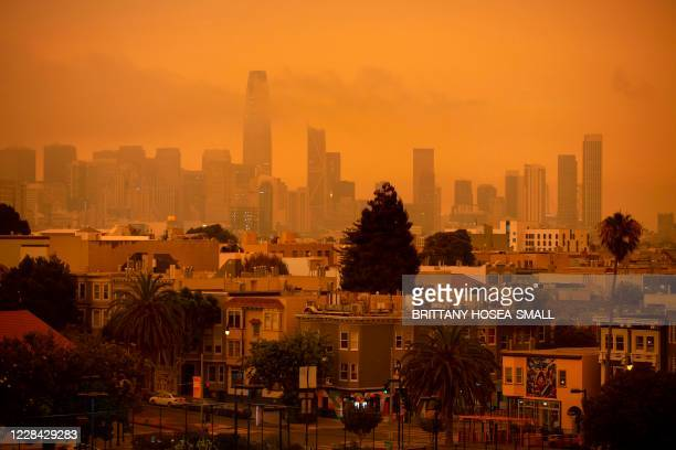 Hazy San Francisco skyline is seen from Dolores Park in San Francisco, California on September 9, 2020. - More than 300,000 acres are burning across...