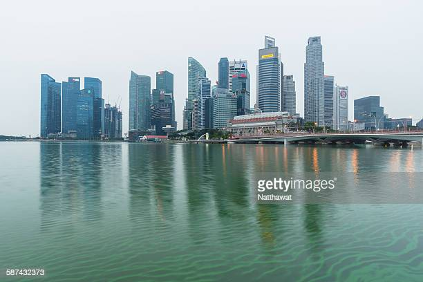Hazy sky of Singapore city with green water