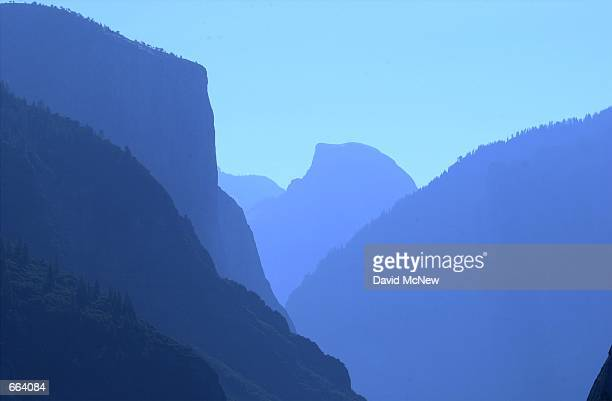 A hazy summer day in Yosemite Valley may be the result of humidity exhaust from vehicles in the valley or polluted air blowing in from far away San...