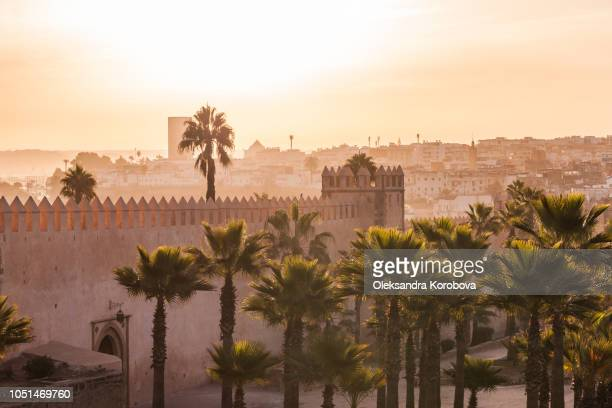 hazy sunrise over the fortress wall of the kasbah of the udayas in rabat, morocco. - rabat morocco stock pictures, royalty-free photos & images