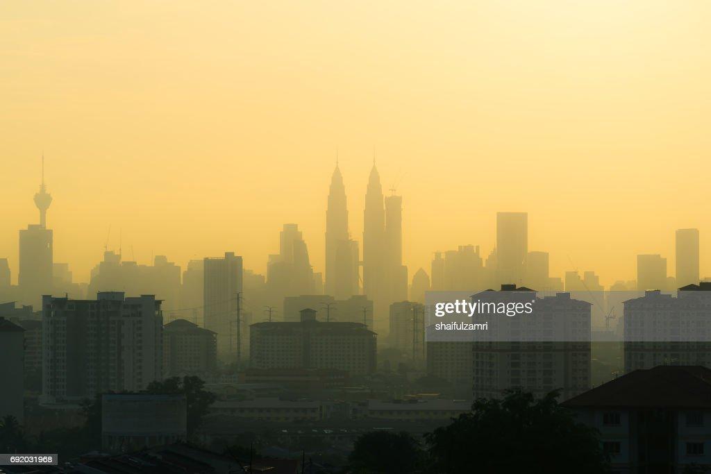 Hazy sunset in downtoen Kuala Lumpur : Stock Photo