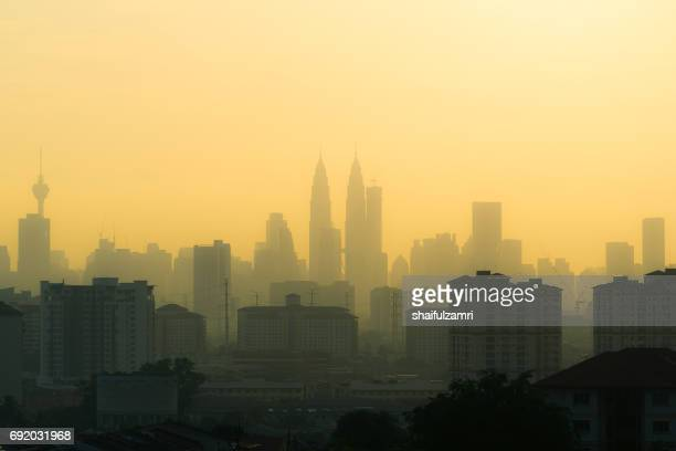 hazy sunset in downtoen kuala lumpur - heat haze stock pictures, royalty-free photos & images