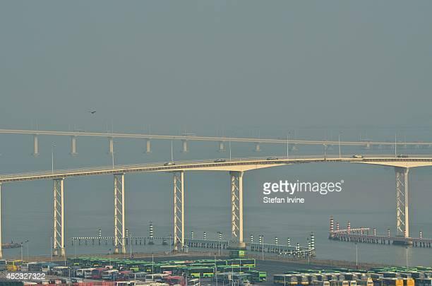 A hazy view of the Governor Nobre de Carvalho Bridge also known as the MacauTaipa Bridge with the Ponte de Amizade or Macao Friendship Bridge in the...