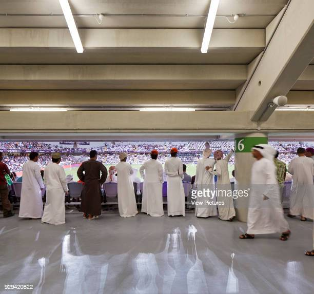 Hazza Bin Zayed Stadium Al Ain Al Ain United Arab Emirates Architect Pattern Design 2014 Stands interior with emirati spectators watching the game