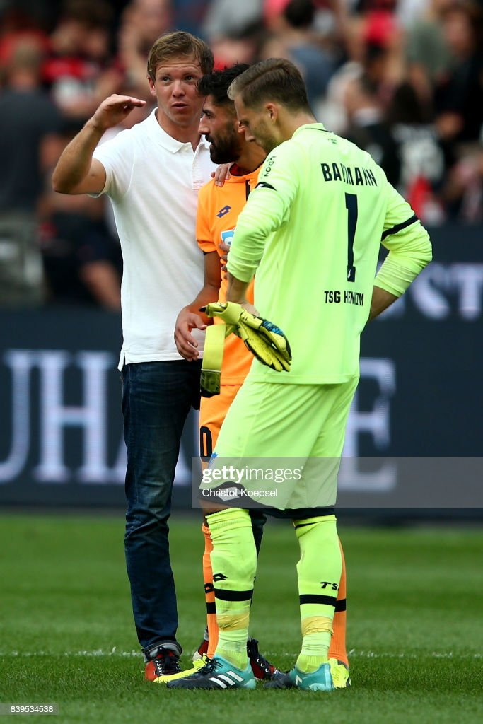 hc Julian Nagelsmann of Hoffenheim speaks to Krem Demirbay and Oliver Baumann of Hoffenheim after the Bundesliga match between Bayer 04 Leverkusen and TSG 1899 Hoffenheim at BayArena on August 26, 2017 in Leverkusen, Germany. The match between Leverkusen and Hoffenheim ended 2-2.