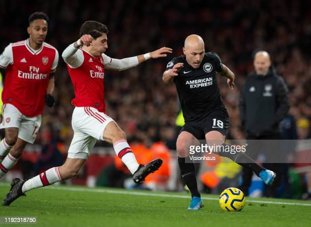Héctor Bellerín of Arsenal and Aaron Mooy of Brighton and Hove Albion during to the Premier League match between Arsenal FC and Brighton Hove Albion...