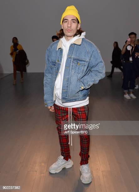 Héctor Bellerín poses on the front row at the Christopher Raeburn show during London Fashion Week Men's January 2018 at BFC Show Space on January 7...