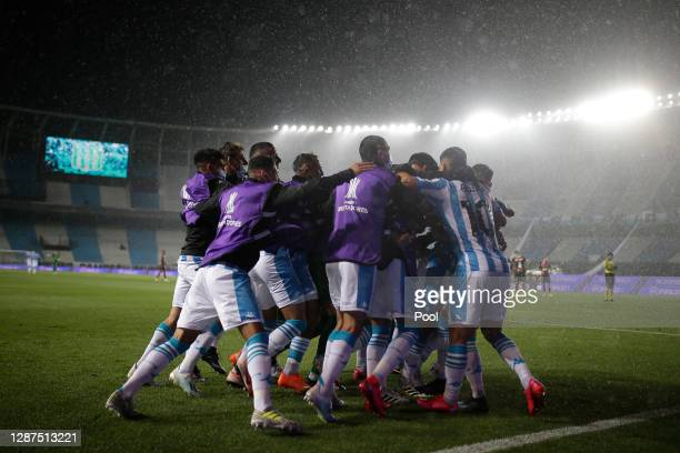 Héctor Fértoli of Racing Club celebrates after scoring the first goal or his team with teammates during a round of sixteen first leg match between...
