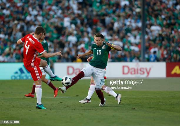 Héctor Herrera of Mexico attempts a pass past Ben Davies of Wales during the game on May 28 at the Rose Bowl in Pasadena CA