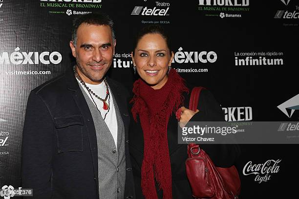 Héctor Suárez Gomís and Sandra Quiroz attend the Wicked red carpet at Teatro Telmex on October 17 2013 in Mexico City Mexico