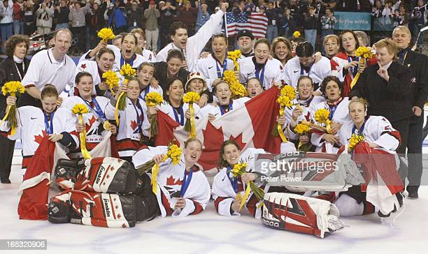 Team Canada celebrates with a team photo on the ice after theirvictory in gold medal final of women's hockey at the Olympic Winter Games in Salt Lake...