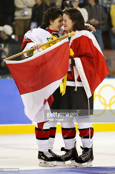 Team Canada's Danielle Goyette and Cassie Campbell embrace after their gold medal victory at the Olympic Winter Games in Salt Lake City Thursday Feb...